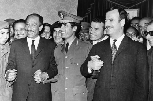 "Gaddafi, Anwar Sadat and Hafez Assad after signing an agreement to establish the ""Federation of Arab Republics"""