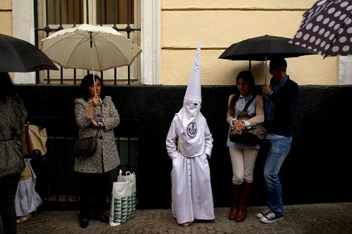 Photograph: Marcelo del Pozo/Reuters There's something very unexpected about this picture of a penitent of La Candelaria brotherhood waiting in the rain during Easter week festivities in Seville, Spain.  See more images of how Easter is being marked across the world in our gallery