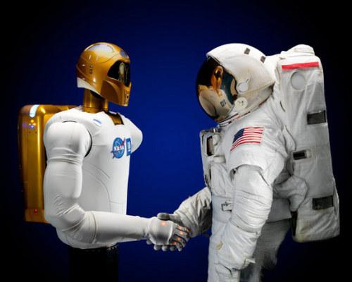 Generations apart. Robonaut 2 meets an Apollo astronaut