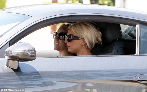 Lady Gaga driving an Audi R8 in Beverly Hills yesterday (unlicensed)