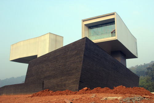 enochliew:  Nanjing Sifang Art Musem by Steven Holl Architects The final result seems a lot clunkier than the initial drawings and model.( really ? ) (MN note:  Photos in my opinion are in general a poor way to access (or judge) architecture…  they (photos) can serve a purpose, but photos are very flat…)