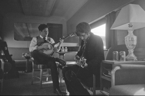 Marcus Mumford of Mumford & Sons and Willie Watson of Old Crow Medicine Show jam on the train during the 2011 Railroad Revival Tour. Photo copyright James Marcus Haney.