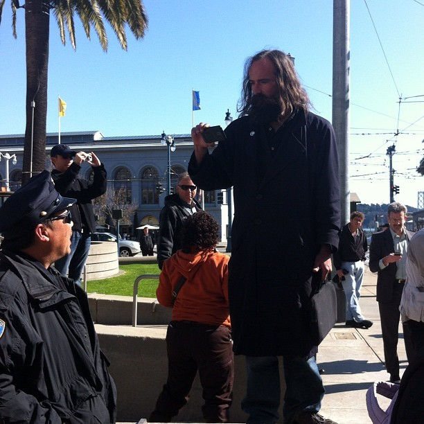 "Some Occupy dude mouthing off at the Muni event. He smelled bad and also, um, Occupy SF sucks. It's no longer about income inequality or social justice. It's just about camping for a  fringe sect that seems to consider ""soap"" a four letter word. A pity, since there's real issues to be dealt with, but these shmoes just want to play camp and act like jerks. Also: the smell.  (Taken with Instagram at F Street Car Muni Stop - Don Chee Way)"