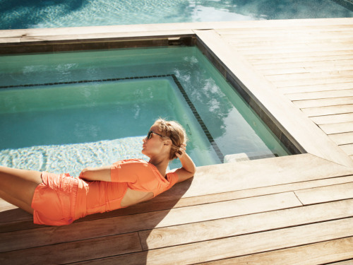 Model Carolyn Murphy soaking up the sun in Adidas by Stella McCartney.