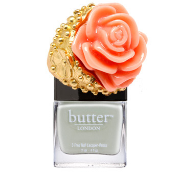 Perf prom nails? Our pick: Play nice with coral and pale pistachio. Butter London 3 Free Nail Lacquer in Bossy Boots. Flower ring from Fantasy Jewelry Box.