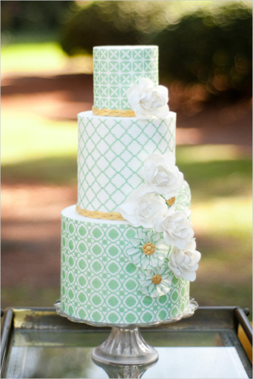 bride2be:  gorgeous graphic green wedding cake, and i love the yellow braids at the bottom of each tier!