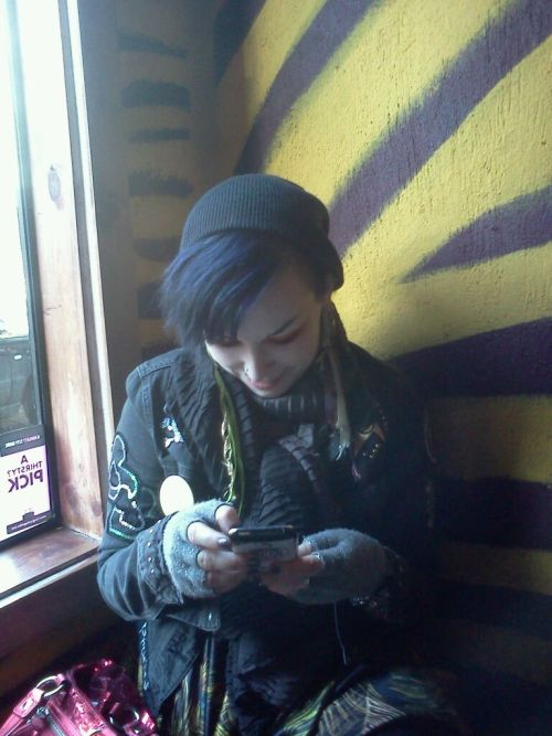 batfeathers:  and this is a gratuitous picture of me texting at the noc-noc (bar)