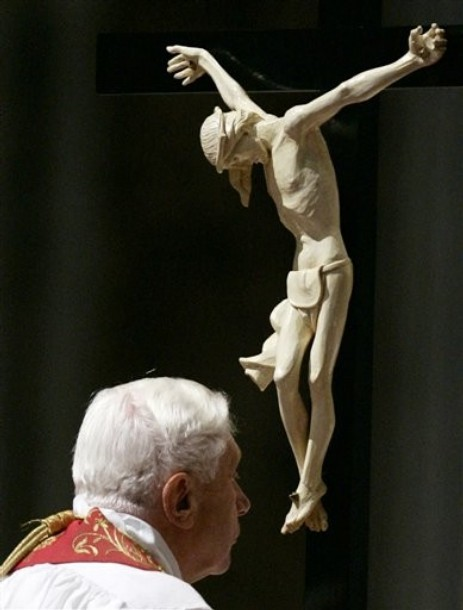 """What does it mean to kiss the cross? In one of the first things that he ever said to me, Pope Benedict XVI in his homily for the closing Mass of World Youth Day 2005 in Cologne, Germany taught us the meaning of adoration:  I like to illustrate this new step urged upon us by the Last Supper by drawing out the different nuances of the word """"adoration"""" in Greek and in Latin. The Greek word is proskynesis. It refers to the gesture of submission, the recognition of God as our true measure, supplying the norm that we choose to follow. It means that freedom is not simply about enjoying life in total autonomy, but rather about living by the measure of truth and goodness, so that we ourselves can become true and good. This gesture is necessary even if initially our yearning for freedom makes us inclined to resist it.  We can only fully accept it when we take the second step that the Last Supper proposes to us. The Latin word for adoration is ad-oratio - mouth to mouth contact, a kiss, an embrace, and hence, ultimately love. Submission becomes union, because he to whom we submit is Love. In this way submission acquires a meaning, because it does not impose anything on us from the outside, but liberates us deep within.   Ad oratio, mouth to mouth, a kiss. As we say at each Station of the Cross, """"We adore Thee, O Christ, and we bless Thee, for by Thy holy cross, Thou hast redeemed the world."""" By venerating the cross, we make a humble act of adoration to Jesus. What a powerful sign! What a truly significant liturgical ritual! But, what is the reason for our adoration?  In reflecting on the connection between the Last Supper and the Crucifixion, Pope Benedict explains in his homily,  By making the bread into his Body and the wine into his Blood, he anticipates his death, he accepts it in his heart, and he transforms it into an action of love. What on the outside is simply brutal violence - the Crucifixion - from within becomes an act of total self-giving love. This is the substan"""