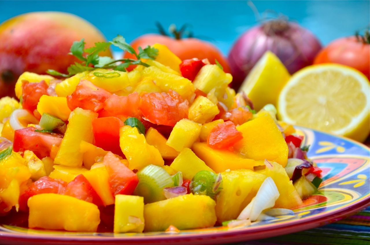 Pineapple Mango Salsa 1 Pineapple 3 Mangos 3 Large Beefsteak Tomatoes 1/2 Red Onion Bundle of Green Onions Bundle of Cilantro 1 Red Bell Pepper Juice of 2 Lemons or Limes Directions: Dice all ingredients and mix into a bowl. Mix all of the ingredients until the juices mix together. When ready, sprinkle with lemon/lime and enjoy!