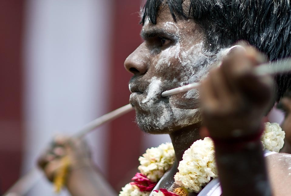Photos of self-inflicted piercings and flagellation are striking to see, but I do find myself tensing up once in a while. Thanks, quelowat:  PIERCING FOR PENANCE: An Indian Tamil Hindu devotee with a steel rod pierced through his cheeks took part in a religious procession for Lord Murugan in New Delhi Thursday. Tamil Hindus seeking penance and blessings of the Lord Murugan, son of Lord Shiva, pierce their bodies and carry pots of milk on their heads. (Manan Vatsyayana/AFP/Getty Images)  ~reblogged by Trent Gilliss, senior editor