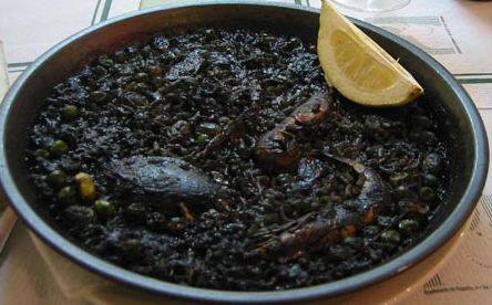 arròs negre : valencia, spain  Though it translates as such this dish should not be confused with black rice, the collective name for several cultivars of heirloom rice that have a naturally dark color. The traditional recipe for this dish calls for squid ink, cuttlefish or squid, white rice, garlic, green cubanelle peppers, sweet paprika, olive oil and seafood broth. It is traditionally not called a paella even though it is prepared in the same manner. Fideuà negra (black noodles in Valencian) is a variation made with noodles instead of rice and is usually served with aioli.