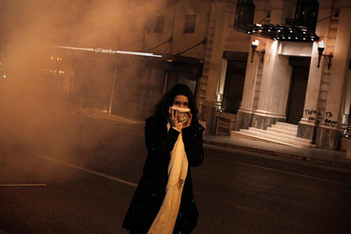 "thepoliticalnotebook:  Picture of the Day: Athens, Greece. A woman covers her face after inhaling tear gas during clashes near parliament.  Read: Matthew O'Brien declares austerity an ""utter disaster"" over at The Atlantic. Check out: The Guardian's ever-reliable and informative live-blogging of the euro-crisis. Photo Credit:  Alkis Konstantinidis/EPA. Via. View more Picture of the Day posts. Submit a photo."