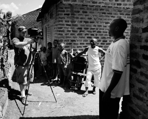 speaking of africa, here's a shot of me shooting in uganda that sarah snapped. glad she documented this..there are typically very few shots of me. note the ultralong™ socks.