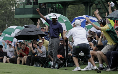 Vijay Singh made one of the shots of the day at the 18th by holing out off the green. This is a great pic of capturing the emotions at the Masters. Wouldn't it be great to see him win this week. He is at 2 under.