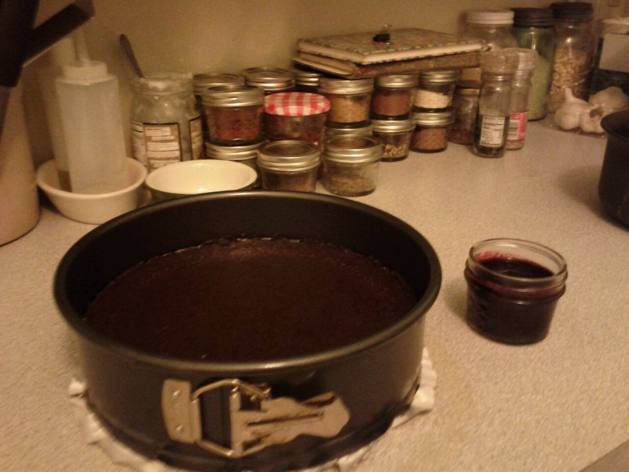 Happening Now : Baking Chocolate Regal with Blackberry Coulis. No sugar or flour. FTW! Ok to be perfectly honest, I used 85% Cacao chocolate, so there is some trace sugar.