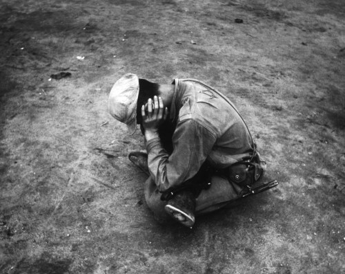 A weary and dispirited survivor of a lost battalion during the Korean War, 1950.
