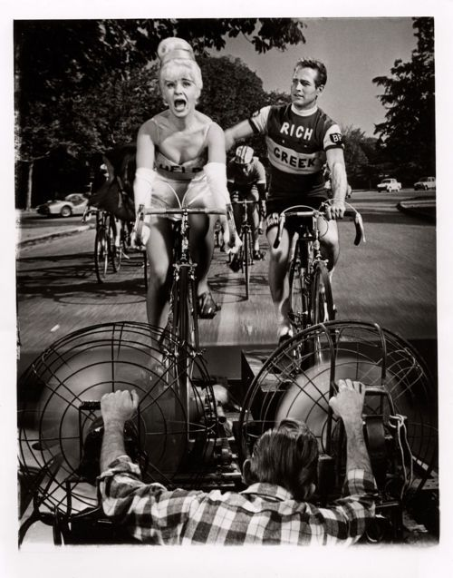 "18milesperhour:  HAPPY FRIDAY. RIDE YOUR BIKE THIS WEEKEND.  Guy probably never turned a pedal before and he looks a thousand times better in that ""Rich Greek"" jersey (wtf??) than I ever would. Damn his handsome, charitable, talented arse. Well, there is that awful, dreadful, goes-on-forever bicycle scene in Butch Cassidy…so we'll call it even. I do love his pineapple salsa, however. Especially in a burrito after a good, long ride. So he's back in the lead. And he also shares a last name with 18milesperhour's own Rhys. No relation. And Rhys' wife is better on a bike than Paul's so advantage, Rhys. (photo courtesy of Rides A Bike)  Kid can't even pedal!"
