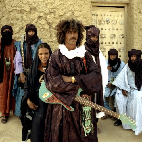 arawellaa:  maxfuckinfreedom:  The dude in the center, Ibrahim Ag Alhabib made his first guitar out of a tin can, a bicycle chain, and a stick. They were forced to fight in Muammar al-Ghaddafi's army, have been living as nomadic refugees through out the Sahara, and recorded their first album in a makeshift studio. They're probably one of the most badass bands of all time.  My favorites.
