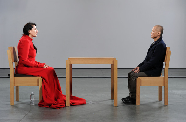 "Marina Abramovic, The Artist is Present, 2010 MoMA held a major retrospective and performance recreation of Abramović's work, the biggest exhibition of performance art in MoMA's history. This performance retrospective traced the prolific career of Marina Abramović with approximately fifty works spanning over four decades of her early interventions and sound pieces, video works, installations, photographs, solo performances, and collaborative performances made with Ulay (Uwe Laysiepen).  During the run of the exhibition, Abramović performed ""The Artist is Present,"" a 736-hour and 30-minute static, silent piece, in which she sat immobile in the museum's atrium, while spectators were invited to take turns sitting opposite her. She sat everyday for the three month period from when the museum opened in the morning till they closed in the evening.This original work performed by Abramovic was the longest single solo piece she's ever performed."