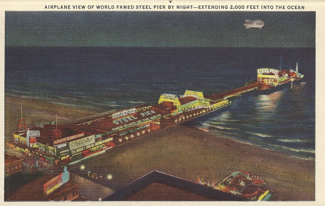 Airplane view of world famed steel pier by night - Extending 2,000 feet into the ocean
