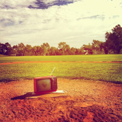 Retro TV on baseball mound on Flickr.