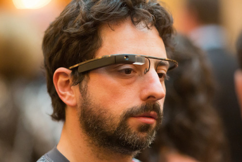 Google Project Glass modeled by Sergey Brin: first high-res photos | The Verge High-res images have now emerged of Sergey Brin stepping out wearing Google's Project Glass heads-up eyeglasses at a charity event last evening. And there's only one thing to do here: enhance!