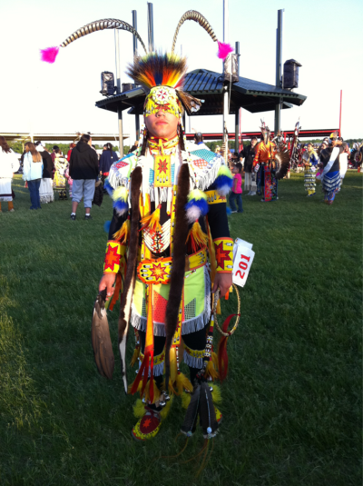 nishnabin:  My cousin Alex in his chicken outfit ! White Earth, Minnesota powwow.