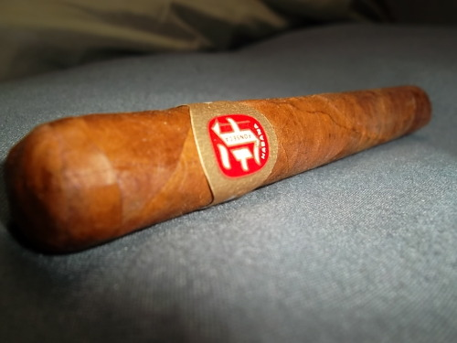 """Fonseca Delicias"" (cuban) This $7.00 cigar had a pre lit aroma of peppery tobacco and wood. Featuring an oily reddish brown habano wrapper with no tooth and large veins. This stick had an extremely tight pack with a draw to match. The smoke output was pretty disappointing due to its tight construction. Very mild bodied with notes of heavy wood and a very slight sweetness. The burn was wobbly and the ash was a dark grey color. I thought that maybe this cigar was plugged but after massaging it I couldn't feel any knots. I would like to chalk this cigar up to bad construction but on previous memories of trying this stick I have never been impressed. Of course this is only my opinion but I can give you a long list of cuban cigars in the same price range which would blow this stick out of the competition. As always, Stay toasting!"