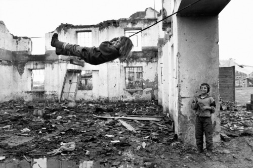 newsweek:  Photographer Peter Turnley's photographs of the Bosnia war are striking. This one is from December, 1994, capturing two kids in Turanj, Croatia finding joy amongst the ruins.  find joy in a hopeless place