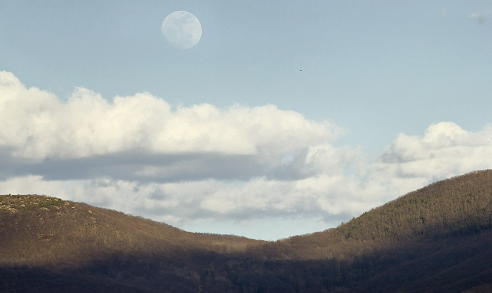 Newburgh, New York - The waxing gibbous moon rises over the Hudson Highlands on April 4, 2012.