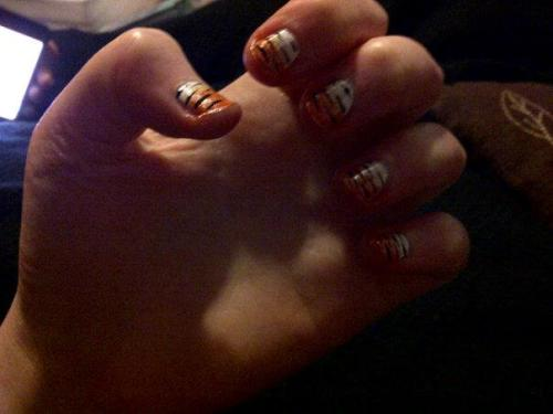 Tiger print nails done on my friend - sorry for the lack of quality in the photo!