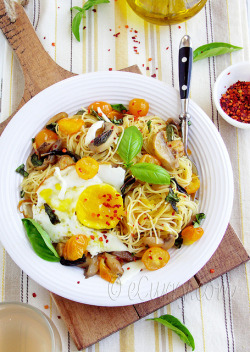 Pasta with loads of Basil & fried Eggs  by Soma.R on Flickr.