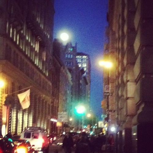 Last night on 18th St, that was either a full moon or the bat signal. I'm thinking the Joker was up to no good. (Taken with instagram)