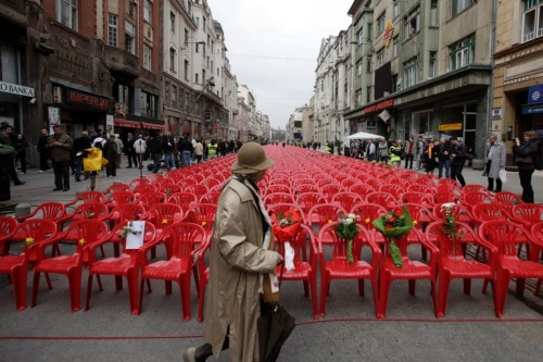 Photo of the Day:  Sarajevo, Bosnia and Herzegovina: 11,541 red chairs are displayed along a main street representing the 11,541 Sarajevans killed during the Bosian war which started 20 years ago today. (Amel Emric / AP Photo) More Photos of the Day