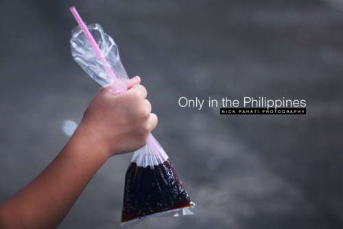 only in the Philippines.. sodas in plastic.. :)