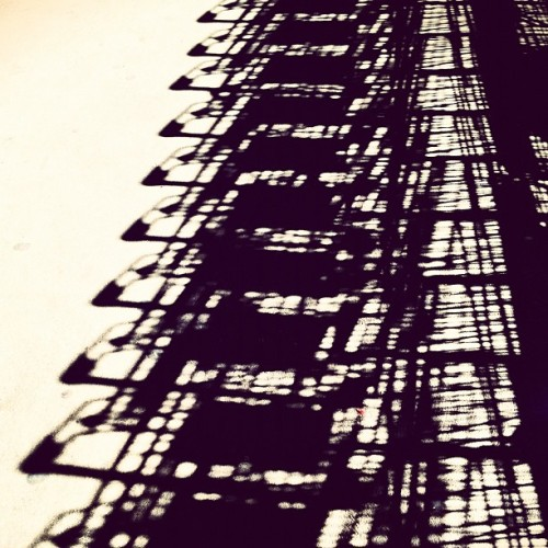 Shadows of Ikea. (Taken with instagram) - The above is an actually good example of what I was talking about here about can be done with a cameraphone and an app. Nice, Hannah. - More scaffolding (I think Hannah's photo is of scaffolding) rev. I see now it is shopping cart shadows.