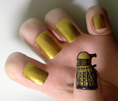 My Dalek nails :) Didn't let the varnish dry before I put it on so it went a bit squashed :(