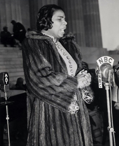 Marian Anderson, singing during an Easter Sunday concert on the steps of the Lincoln Memorial on April 9, 1939. The concert was broadcast on the radio across the nation and the integrated audience of 75,000 including members of the Supreme Court, Congress, and President Roosevelt's cabinet. The concert was organized after the Daughters of the American Revolution refused to allow Ms. Anderson to sing to an integrated audience at Constitution Hall in Washington, D.C. solely because of her race. Photo via The Library of Congress.