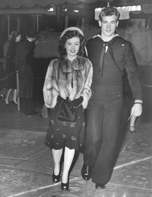 Shirley Temple and Guy Madison arrive at the 17th Annual Academy Awards, 1945. Note: She's wearing a skirt here that is patterned with her initials. I'm still not sure whether this is a custom piece or part of a retail/high fashion collection.