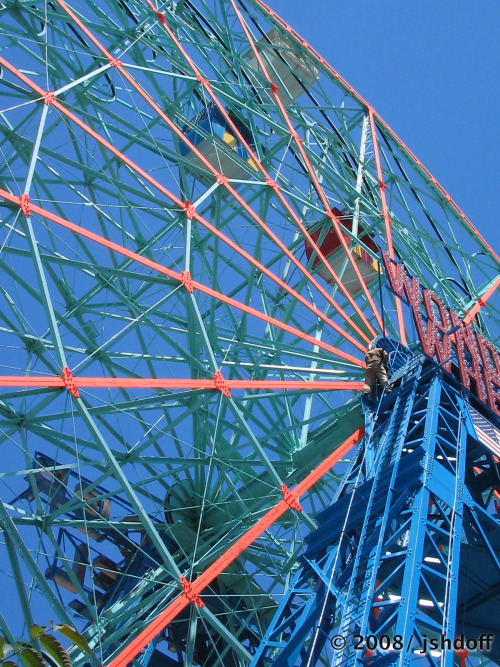 "One step closer to God. Built in 1920, the Wonder Wheel's original patent, for an ""amusement apparatus"" is a work of art, the finished product, a testament to Bethlehem Steel, with one car especially reserved for the ferris wheel dog. (coney island, brooklyn, ny)"