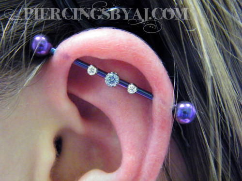 "piercingsbyaj:  This is how I got to end my night. Fresh 14g triple gem industrial piercing with 3mm prong set tanzanite center gem and two 2mm prong set CZ gems, barbell anodized ""blurple"" by me in the studio. All jewelry shown from Anatometal. www.PiercingsByAJ.com  超理想!"