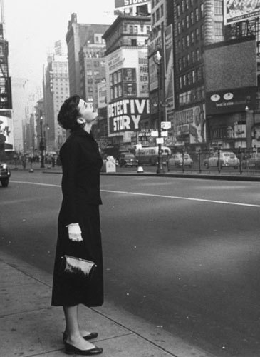 New Year's Day, 1951: Audrey Hepburn looks up at billboards in the middle of Times Square, New York. She had recently been in town for the run of the Broadway show Gigi.