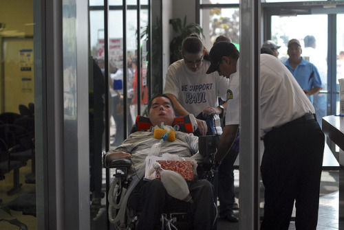 occupysdphotography:  Occupy Medi-Cal | Health care for Raul on Flickr. Via Flickr: Raul Carranza enters the Medi-Cal building in Chula Vista to deliver a list of demands to be faxed to California Governor Jerry Brown on April 6, 2012. (Johnny Nguyen)