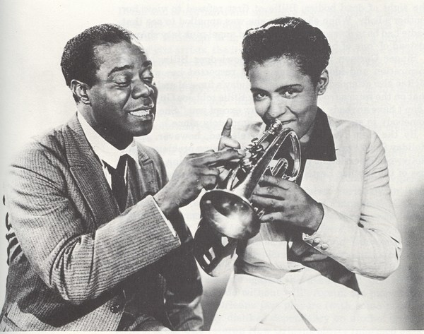 fuckyeahbillieholiday:  Billie Holiday and Louis Armstrong during a promotional shoot for their movie New Orleans.