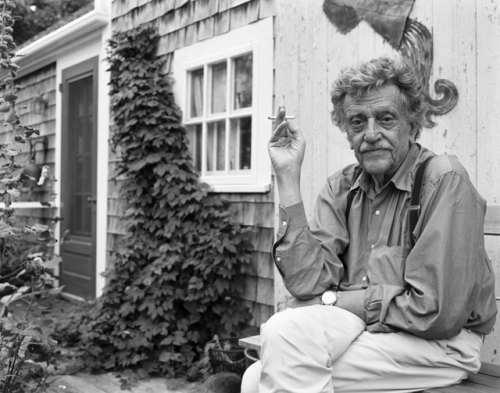 Fashion Fridays with Kurt Vonnegut! …So, this is embarrassingly late. But it's still technically Friday, so it counts! I didn't forget completely; I just had a crazy busy day. At any rate, let's get down to brass tacks. Suspenders.Holy shit, Kurt in suspenders. I didn't know how much I needed that in my life until I saw this photo. He just looks good, and yet so casual. Not to mention, this is the same way he holds his cigarette in that photo of him that reminds me of my dad (the one in front of the house). I suppose that must have been a habit of his.