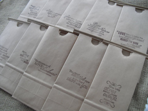 Super simple idea!  Famous loved quotes rubber-stamped onto kraft paper lunch bags.  Super cute favors bags for your wedding!