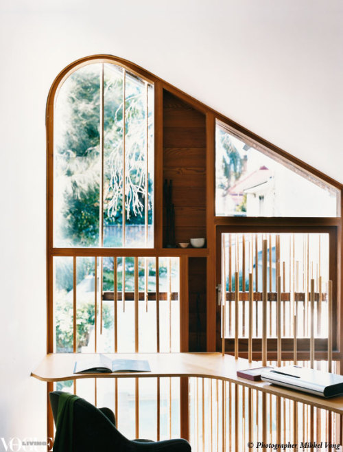 A hoop pine plywood bench wraps around a window and follows the mezzanine floor line to create a study desk on the upper level of this semi-detached cottage. From 'Almost Perfect', a story on page 116 of Vogue Living Sept/Oct 2009. Photograph by Mikkel Vang