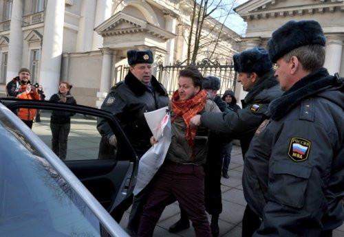 "occupyallstreets:  Two Gay Men Arrested In Russia For Holding A Sign That Read ""Homosexuality Is Normal"" For the first time, police in St. Petersburg, Russia, have made arrests on the strength of a new law banning the dissemination of information on homo-, bi- and transsexuality. Two men were arrested in the city center on Thursday after holding up a sign reading ""Homosexuality Is Normal,"" according to the newswire Interfax. Russia's second-largest city passed the controversial law on Feb. 29. The two men now face a possible maximum fine of 500,000 rubles (€12,800/$17,000). The maximum penalty is more than the average annual income in Russia. The law bans films, music videos, books and newspapers that contain homosexual content as well as the rainbow flag, which is a common symbol of gay pride. And the ban may soon no longer be limited to just St. Petersburg and other cities in Russia. At the end of March, Vladimir Putin's United Russia party introduced a bill in the country's parliament, the Duma, which would impose the ban at the national level. ""We are trying to protect our society from homosexual propaganda,"" Russian Foreign Minister Sergei Lavrov said on Russian radio three weeks ago. Source"