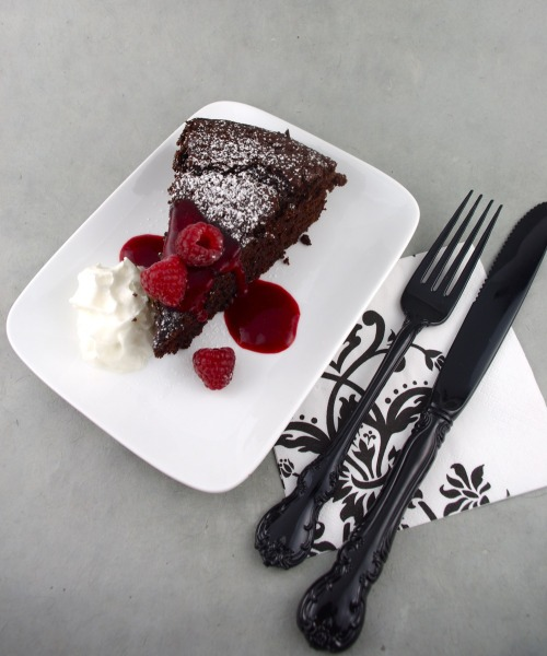 simplydelishdarling:  Chocolate Cake with Olive Oil and Maple Syrupand Raspberry Coulis  Ingredients 1 cup whole wheat pastry flour (I used white whole wheat flour)1 cup flour (all-purpose or cake flour)½ cup unsweetened cocoa powder2 tsps baking powder1 tsp baking soda1 tsp ground cinnamon½ tsp salt1 ½ cups pure maple syrup1 cup water½ cup pure olive oil (or can be replaced with ½ cup melted unsalted butter)2 tsps vanilla1 tsp cider vinegar Method Preheat the oven to 350°F (180°C). Lightly oil a 9-inch x 2-inch round (23-cm x 5-cm) cake tin, line the bottom with parchment paper, lightly oil the parchment then dust the bottom and sides of the tin with flour, shaking out the excess.In a large mixing bowl, sift together the flours, cocoa, baking powder, baking soda, cinnamon and salt. Whisk to combine.In a separate bowl or large measuring cup, combine the maple syrup, water, olive oil, vanilla and vinegar. Whisk to combine.Now it is simply a question of pouring the wet ingredients into the dry and blending well either with a whisk, a wooden spoon or a hand mixer, though I prefer using a whisk here. The best method for doing this so you don't end up with dry ingredients splattered all over your countertop and so you end up with lump-free batter is to first make a well in the center of the dry ingredients. Pour about a quarter of the liquid ingredients into the well, and with small, brisk circular movements, whisk the liquid with just enough of the dry ingredients until you have a thick, smooth, lump-free paste in the center. Add some more of the liquid, pull in a bit more of the dry and briskly whisk again until, aha! your batter is smooth. Continue until all the dry ingredients have been incorporated into your (now) lump-free batter, add any remaining liquid ingredients and give it a go. Pour this batter into your pans and bake until the center of your cake or layers is just firm to the touch, about 25 to 30 minutes, depending upon your oven as well as how firm you would like the center of the cake.Remove the cake from the oven to a cooling rack and allow to cool for about 20 minutes in the pan. Slide a knife around the edges to loosen, the flip the cake over onto a cooling rack, peel off the parchment paper then flip upright onto another rack and allow to cool completely. Transfer the cool cake to a serving platter and prepare the Raspberry Coulis. Raspberry Coulis 2 cups raspberries, fresh or frozen, thawed2 Tbs pure maple syrup½ tsp vanilla extractPurée the raspberries in a blender or processor and then strain to remove the seeds. Stir in the maple syrup and the vanilla.