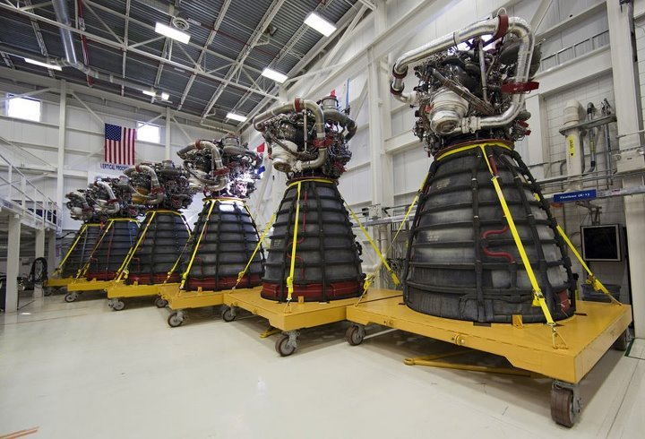 Lined up in a row, six dismantled Pratt & Whitney Rocketdyne space shuttle main engines sit on stands inside the Engine Shop at NASA's Kennedy Space Center on October 14, 2011. For the first time, all 15 main engines were in the Engine Shop at the same time. They were being prepared for shipment to NASA's Stennis Space Center in Mississippi for storage following the completion of the Space Shuttle Program. The engines are being repurposed for use on NASA's Space Launch System heavy lift rocket. Photo by Dimitri Gerondidakis.